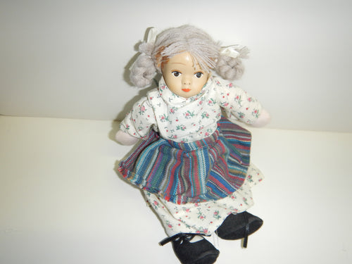 Antique Doll With Pigtails