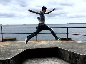 My son practising Parkour moves on the coast of Cornwall