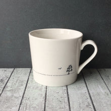 White porcelain mug printed with 'I don't give a sip' all the way around.