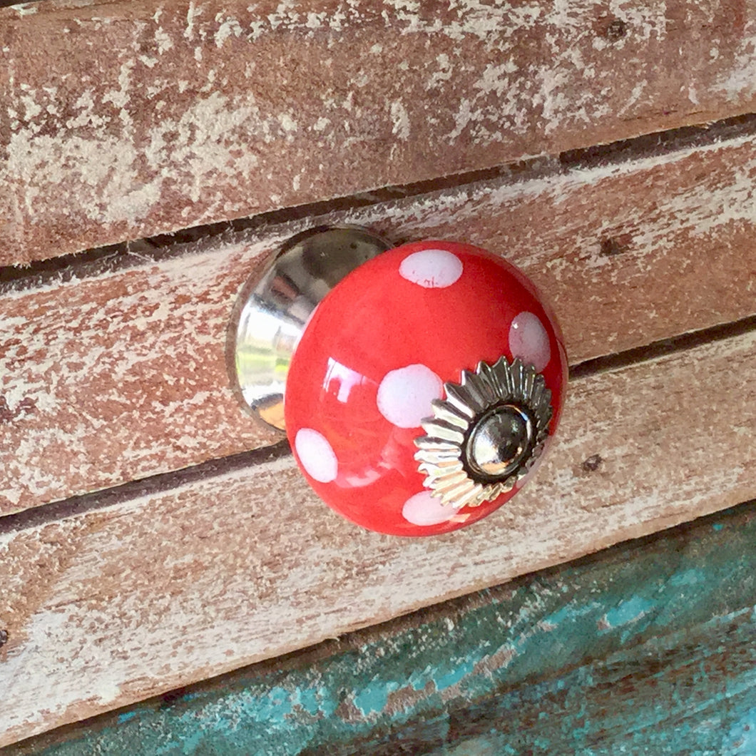 cheerful red polka dot ceramic drawer pull.