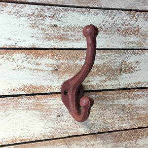 Red Vintage style metal coat hook painted with a distressed finish.