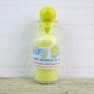 little bottle of neon yellow fairy dust body glitter