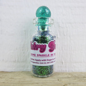 little bottle of green fairy dust body glitter