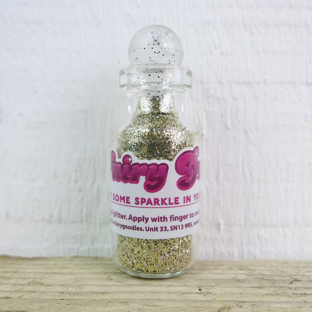little bottle of gold fairy dust body glitter