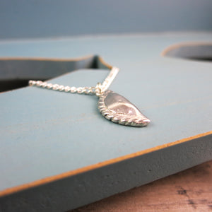 side view of pewter Cornish pasty pendant
