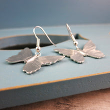 side view of pewter Butterfly earrings on silver plated stems