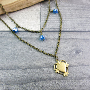 vintage style double necklace with blue glass beads and gold colour heart
