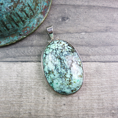 large turquoise pendant set in sterling silver