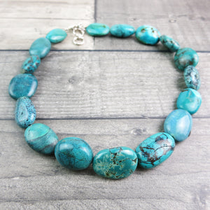 close up of turquoise stone necklace