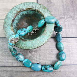 Turquoise stone necklace with sterling silver t-bar and extender rings