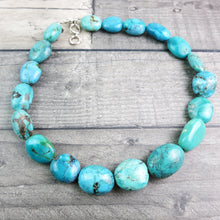 close up of Turquoise stone necklace laid out