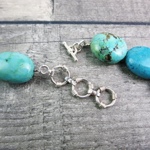 close up of sterling silver t-bar and extender rings on Turquoise stone necklace