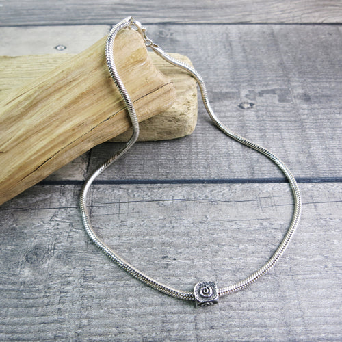 sterling silver snake chain with square spiral patterned bead