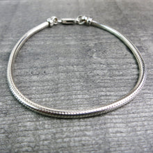 close up of sterling silver snake chain bracelet