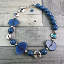 Navy blue large statement necklace made using vegetable ivory and silver covered clay beads