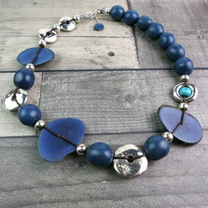 Blue and silver large statement necklace made using vegetable ivory and silver covered clay beads