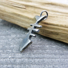 side view of oxidised silver fishbone pendant