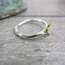 side view of silver ring with hammered brass heart