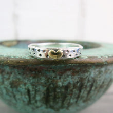 Sterling silver band ring with tiny brass heart and dotty details