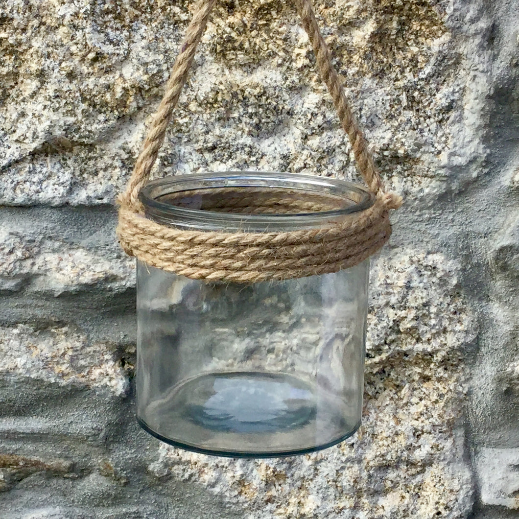 Chunky glass hurricane lantern wrapped with rope.