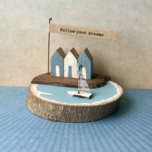 Handmade beach hut and sail boat scene on wooden base, from East of India.
