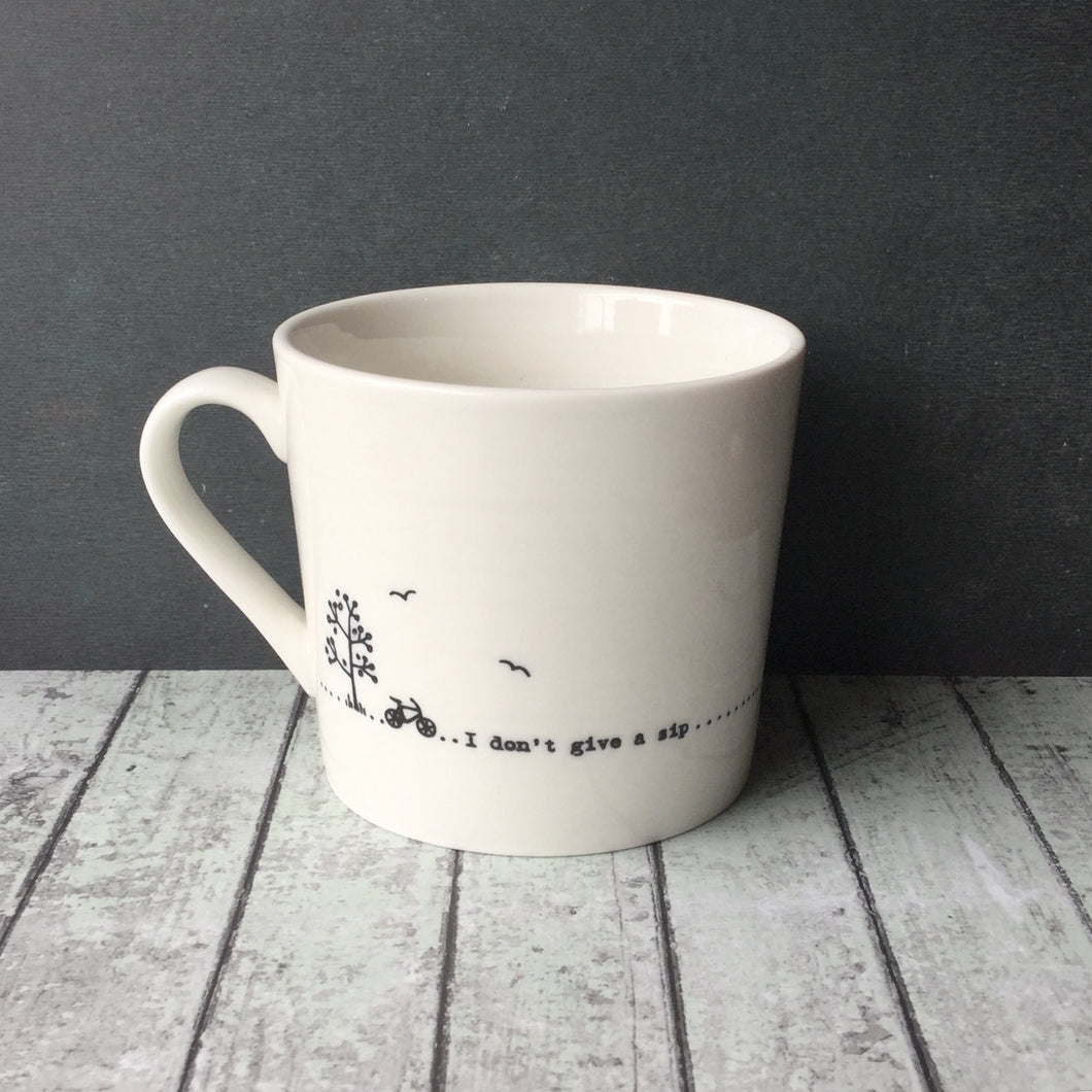 White porcelain mug printed with 'I don't give a sip' printed all the way around.