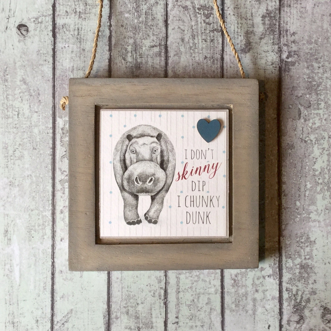 wooden plaque with a Hippo illustration and text I don't skinny dip I chunky dunk
