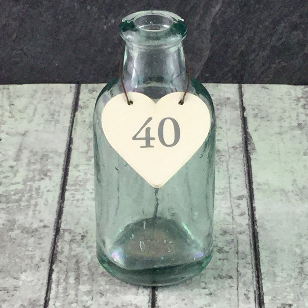 Little cream wooden heart with the number 40 printed in grey and a wire to hang