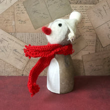 painted wooden penguin with knitted hat and scarf
