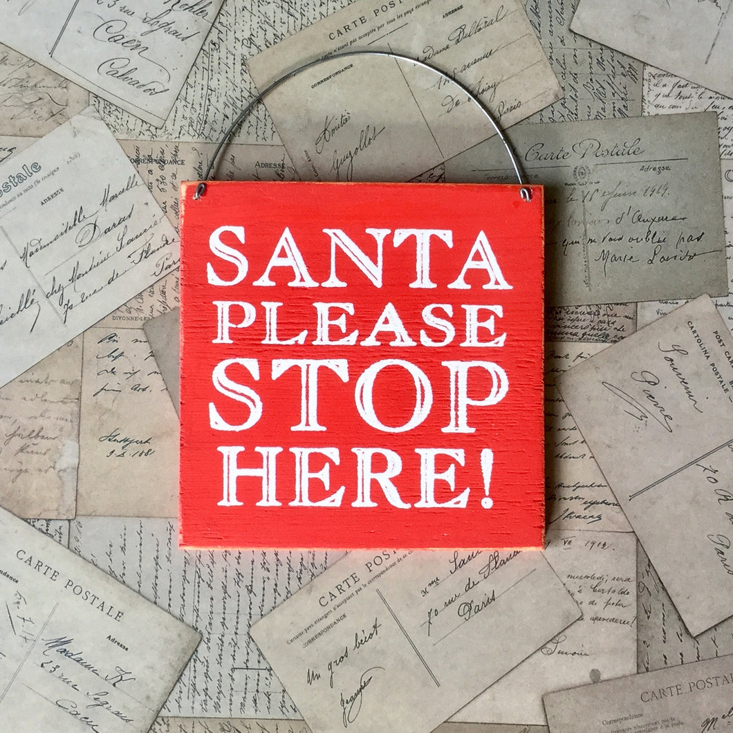 red wooden Santa stop here sign