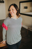 Women's black and white stripe shirt with red arm ruffle