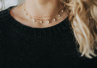 Gold multi strand choker with freshwater pearls
