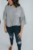 women's grey cropped tee with ruffle sleeves and pearl shoulder detail