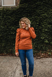 women's burnt orange puff shoulder Pom Pom fall sweater
