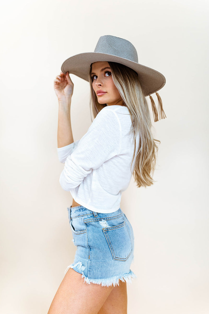 DESTIN-ATION TASSEL HAT IN GRAY