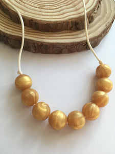 Goldie Silicone Teething Necklace