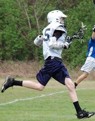 Zach playing Lacrosse