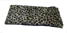 Eye pillow -top angle view -black snow leopard print on creamy white faux fur background
