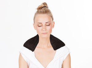 Female model wearing neck wrap - chocolate brown swirl velour