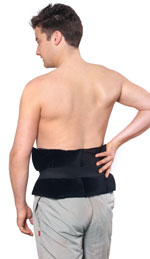 Sports heating pad wrap secured with strap around lower back of a man standing - black velour