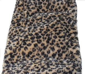 "Top angle view -rectangle body wrap 9""x19"" -leopard print fur with cream background -reverse side black velour"