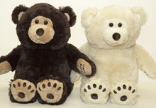 Brown and creamy white smiling therapeutic teddy bears sitting side by side with bear paw print feet