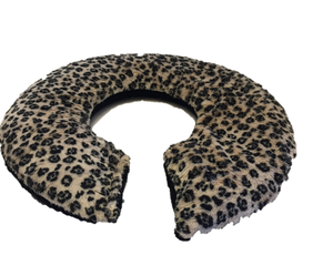 Black snow leopard print on creamy white background faux fur C-shaped aromatherapy shoulder wrap -top angle view- reverse side in soft black velour.