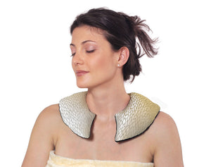 Female model wearing C-shaped shoulder wrap - gold silk with shimmering leaf pattern