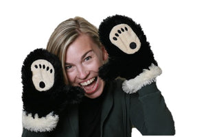 Woman wearing black & cream bear paw print mittens