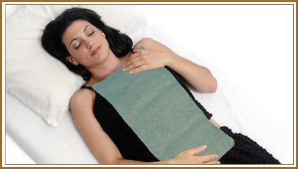Body wrap laid across female model front torso -aqua swirl velour