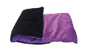 "Folded side angle view -rectangle body wrap 9""x19"" -purple violet swirl velour -reverse side black velour"