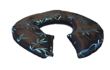 Front angle view -C-shaped shoulder wrap in chocolate brown silk with shimmering aqua blue bamboo leaf embroidery- reverse side black velour