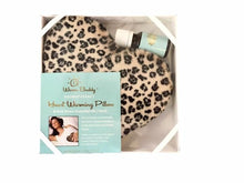 Leopard print fur heart-shaped heating pad inside clear lid gift box with elastic ribbon corners & anti-stress pure essential oil bottle - top view