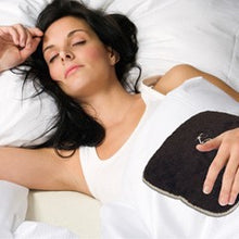 "Woman lying down with small stomach heating pad 9""x9"" on stomach - chocolate brown swirl velour"